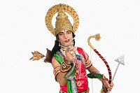 Portrait of a stage artist dressed_up as Rama the Hindu mythological character and pointing