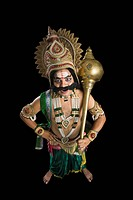 Portrait of a stage artist dressed_up as Ravana and holding a mace