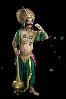 Man dressed_up as Ravana and blowing bubbles