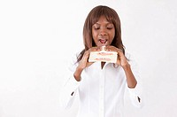 Young woman holding a sandwich with mouth open (thumbnail)