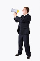 Businessman standing and shouting with a megaphone