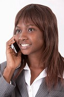 Close_up of young businesswoman using mobile phone and smiling