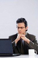 Businessman looking at a laptop