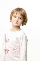Dark_blonde, 8_year_old girl wearing a white top