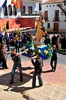 Men carrying a statue of the Virgin Mary, Semana Santa, Holy Week procession in La Nucia, Costa Blanca, Spain