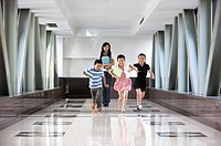 Child, Four children running on the corridor with their teacher
