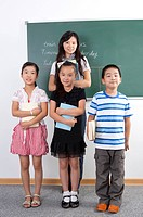Child, Children standing and holding books with teacher in the classroom