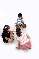 Child, Children sitting on the floor and playing toy bricks together