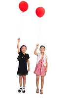 Child, Two girls standing and holding balloon with smile together