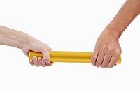 Human hands holding relay baton together