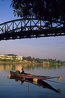 longtail speedboat in Mae Nam Kwae Yai, River Kwai, under bridge on Death Railway, Bridge on the River Kwai, Kanchanaburi, Thailand