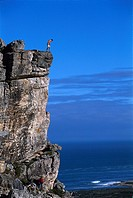 A group of rock climbers climbing, Kleinmond, South Africa