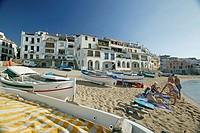 Costa Brava, Bathers on the beach at Calella, Costa Brava, Catalonia Spain