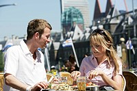 NLD Netherlands The Hague: Young couple in a cafe on the Buitenhof Square. ,