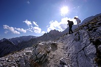Hikers on north slope of the Alpspitze, Wetterstein Mountains, Bavaria, Germany