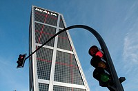 KIO Tower and red traffic light. Plaza de Castilla, Madrid, Spain