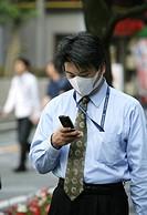 JPN, Japan, Tokyo: Mobile phone user