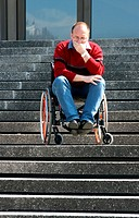 waiting man in a wheel chair on a stair