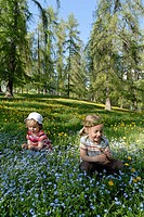 Two girls on a flower meadow, South Tyrol, Italy, Europe