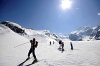 Skiers on slope, Morteratsch valley, Bernina range, Grisons, Switzerland