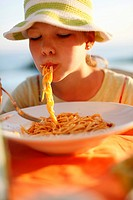 Girl eating spaghetti, Formentera, Balearic Islands, Spain