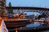 Promande and small Marina at False Creek at twilight, Granville Bridge, Vancouver, Canada, North America