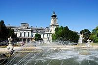 Festetics Castle with fountain under blue sky, Kastely Festetics, Keszthely at Lake Balaton, Hungary, Europe