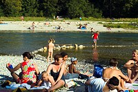 People sunbathing and bathing at Isar River, Munich, Bavaria, Germany