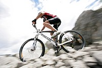 Person mountain biking near Tre Cime di Lavaredo, Veneto, Italy