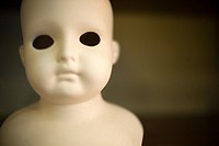 head and bust eyeless porcelain doll.,