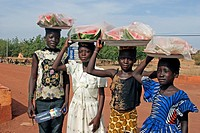 Children carrying fruit on their heads, Sahel, Mali, Africa
