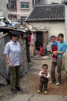 Friendly women with their children in the slums of Dong Guan, China