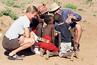 Tourists meet curious Turkana children, Kenya, Africa