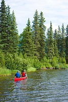 Mother and daughter paddling a canoe together on Byers Lake, Denali State Park, Southcentral Alaska, Summer