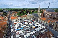 The church of Saint Walburga, the belfry and stallholders at the Central Market Square, Veurne, Belgium