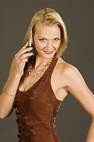 young blond woman phoning with cellphone