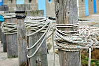 Knots in ropes of moored boats at Port Racine, the smallest harbour in France at Saint_Germain_des_Vaux, Normandy