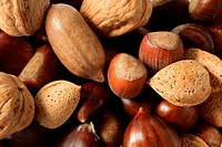 Nuts mix, walnuts, pecam hazelnut, almond, chestnut, crop texture background