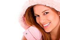 beautiful woman wearing a pink winter jacket with fur hood, smiling