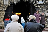 People praying at the Oostakker_Lourdes place of pilgrimage, Belgium