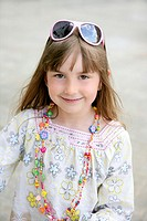 Beautiful little girl portrait outdoors in the city
