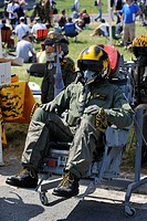 Fighter jet pilot wearing helmet sitting in ejection seat at airshow in Koksijde, Belgium