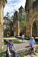 Tourists visiting the Orval Abbey ruins, a Cistercian monastery founded in 1132 in the Ardennes, Belgium