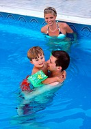 young family in a swimming pool