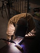 Steel worker in metal shop