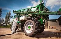 Crop spraying. Pesticide being added to a crop sprayer´s tank. This crop sprayer is being prepared by Nigel Durdy, a finalist in the Farm Sprayer Oper...