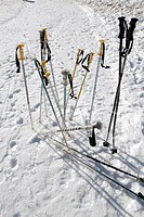 ski poles planted in the snow