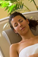 young attractive woman relaxing with closed eyes
