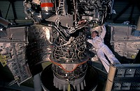 Passenger aircraft construction. Turbo jet engine of an Airbus passenger plane being prepped and mounted on the strut which joins the engine to the wi...