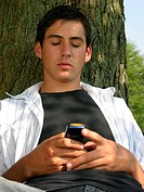 Male teen sendin text messages